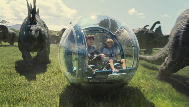 "Nick Robinson and Ty Simpkins star in ""Jurassic World,"" now in theaters."