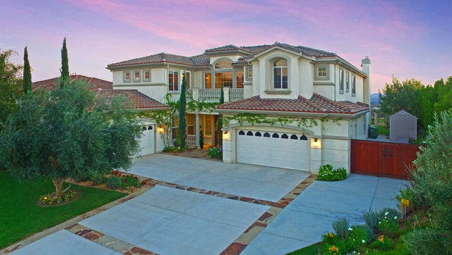 Located on more than one-half acre, 12304 Palmer Drive is 5,851 square feet, the largest floor plan in the community and one of the very few in Country Club Estates on a lot that is this desirable size and shape.