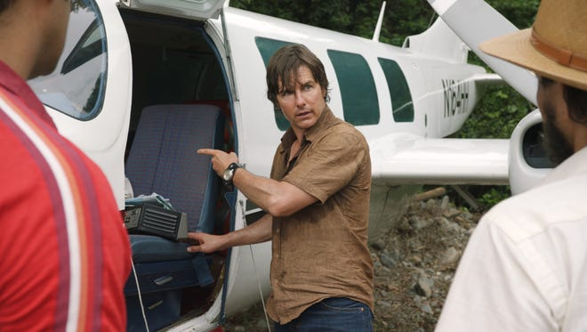 """In """"American Made,"""" Barry (Tom Cruise) is a bored TWA pilot who makes extra cash smuggling Cuban cigars"""