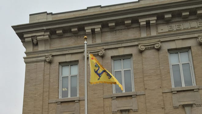 The Qing Dynasty flag flies in front of Town Hall in Belleville April 4, 2016.