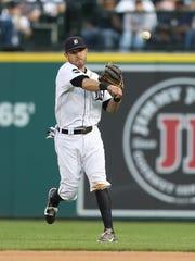 Tigers second baseman Ian Kinsler throws out the Toronto's