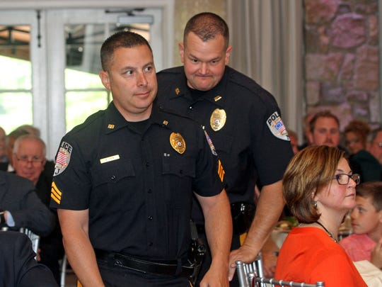 Bound Brook Police Valor Award winners Sgt. Robert Lavin (left) and Detective Peter Romanyszyn go up to receive their awards at the Somerset County 200 Club luncheon at Fiddler's Elbow Country Club in Bedminster.