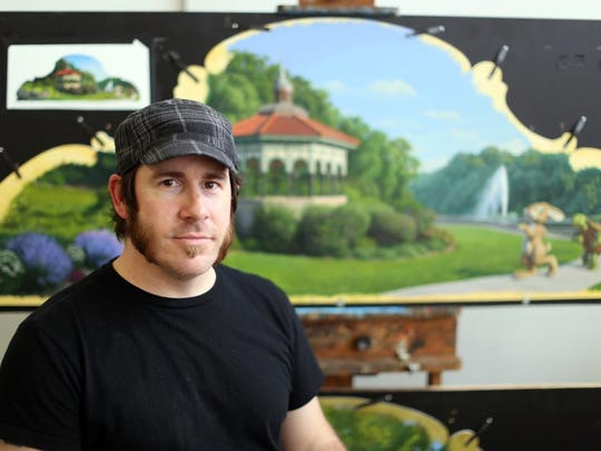 Jonathan Queen of Anderson worked on a years-long commission to design the artwork for the Carol Ann's Carousel, the year-round carousel that will open in Smale Riverfront park in the spring of 2015.