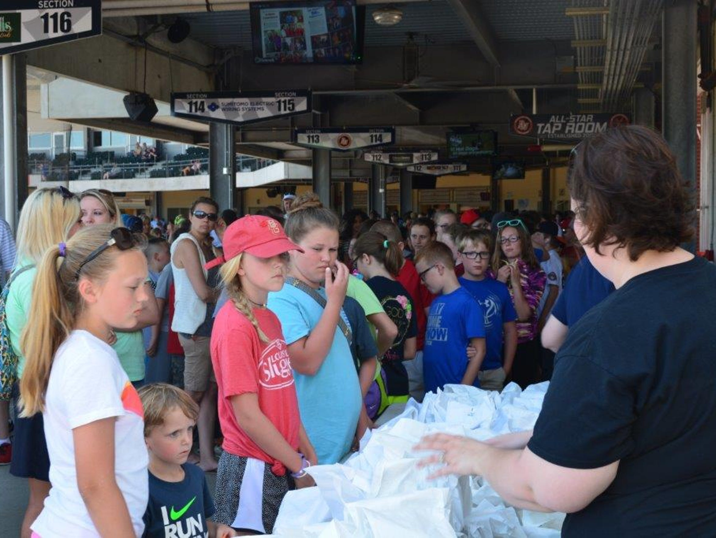 Young fans line up to get popcorn at an April 26 Bowling