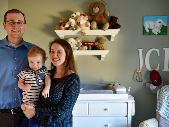 James, left, and Chelsea Lamb hold their 14-month-old