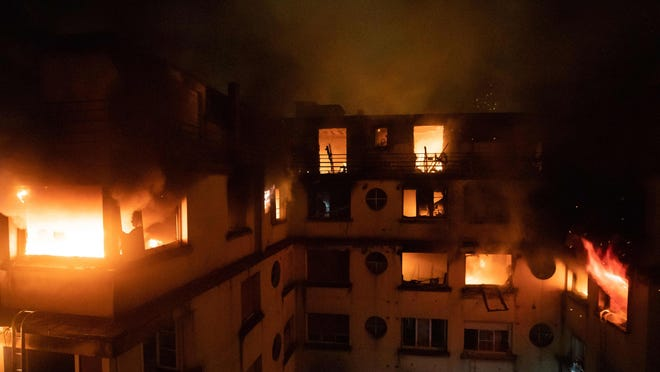 This handout picture taken and released by the Paris firefighters brigade on Feb. 5, 2019, shows a fire in a building on Erlanger street in Paris, that killed 10 people.