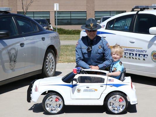 636591544371876758-lcso-deputy-son-gets-hot-wheels-car.jpg