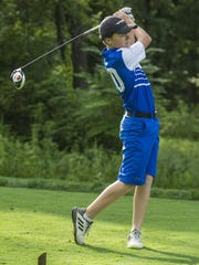 Shane Quinn, 13, of Morristown watches his drive during
