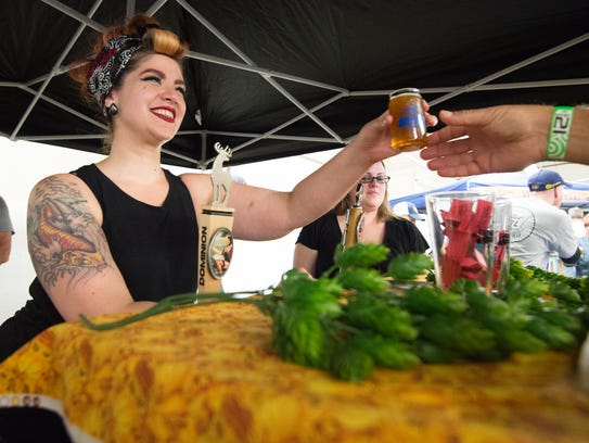 Jessica Besecker with Dover's Fordham & Dominion Brewing Company serves spiced harvest beer at the 2017 Delaware Wine and Beer Festival -- an event organized by Kent County Tourism each fall.
