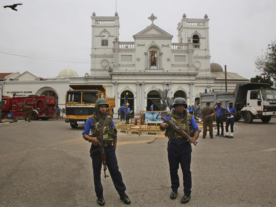 Sri Lankan Naval soldiers stand outside damaged St. Anthony's Church, in Colombo, Saturday, April 27, 2019.