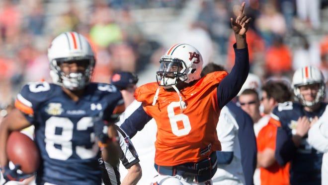 Auburn wide receiver Ryan Davis (83) runs downfield during Auburn's NCAA spring college football game Saturday, April 9, 2016, in Auburn, Ala.
