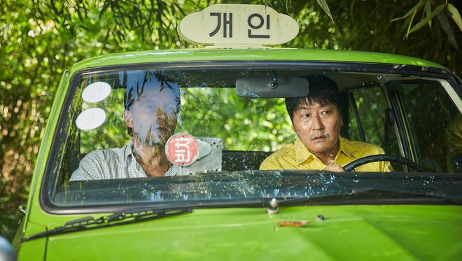 "Thomas Kretschmann and Kang-ho Song star in ""A Taxi Driver."""