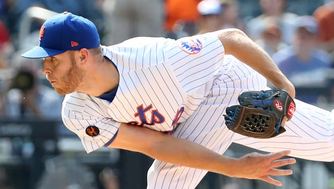 Jul 14, 2018; New York City, NY, USA; New York Mets starting pitcher Zack Wheeler (45) pitches during the first inning against the Washington Nationals at Citi Field.