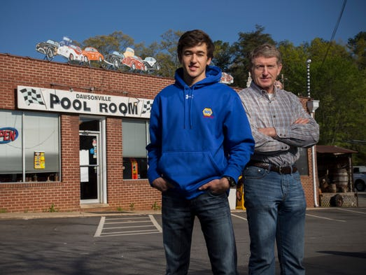 Chase Elliott, left, and his father Bill Elliott stand in front of the Dawsonville Pool Room. Bill Elliott is a former NASCAR Cup champion, and Chase is a rookie in the NASCAR Nationwide Series.