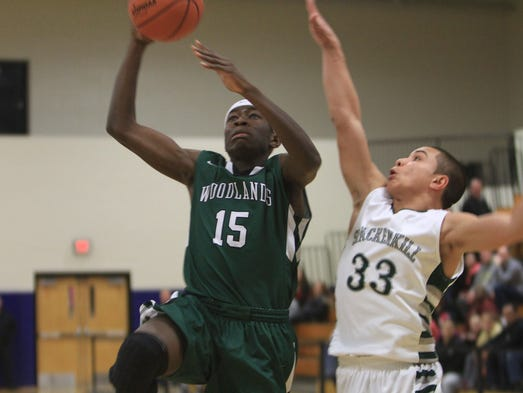 Woodlands' Ross Joseph (15) goes up for a shot in front of Spackenkill's Cameron Abalos (33) during the boys regional Class  B state semifinal basketball game at Mount Saint Mary College in Newburgh March 4, 2014. Woodlands won the game 53-46.