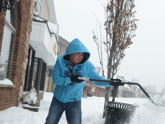 Miguel Perez clearing the sidewalk in front of Tony's