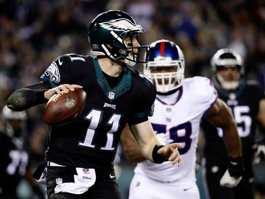 Philadelphia Eagles' Carson Wentz looks to pass during the first half of an NFL football game against the New York Giants, Thursday, Dec. 22, 2016, in Philadelphia. (AP Photo/Matt Rourke)