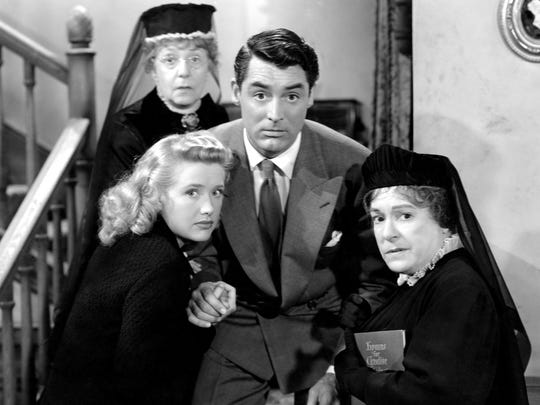 "Cary Grant, center, finds some, um, skeletons in the family closet in ""Arsenic and Old Lace."""