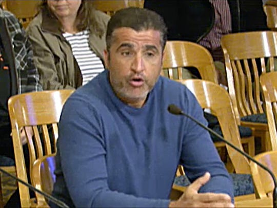 Youssef Berrada, a landlord who owns nearly 300 buildings and 3,500 rental units in the Milwaukee area, appears before a City of Milwaukee zoning hearing to acquire another property in April 2018.