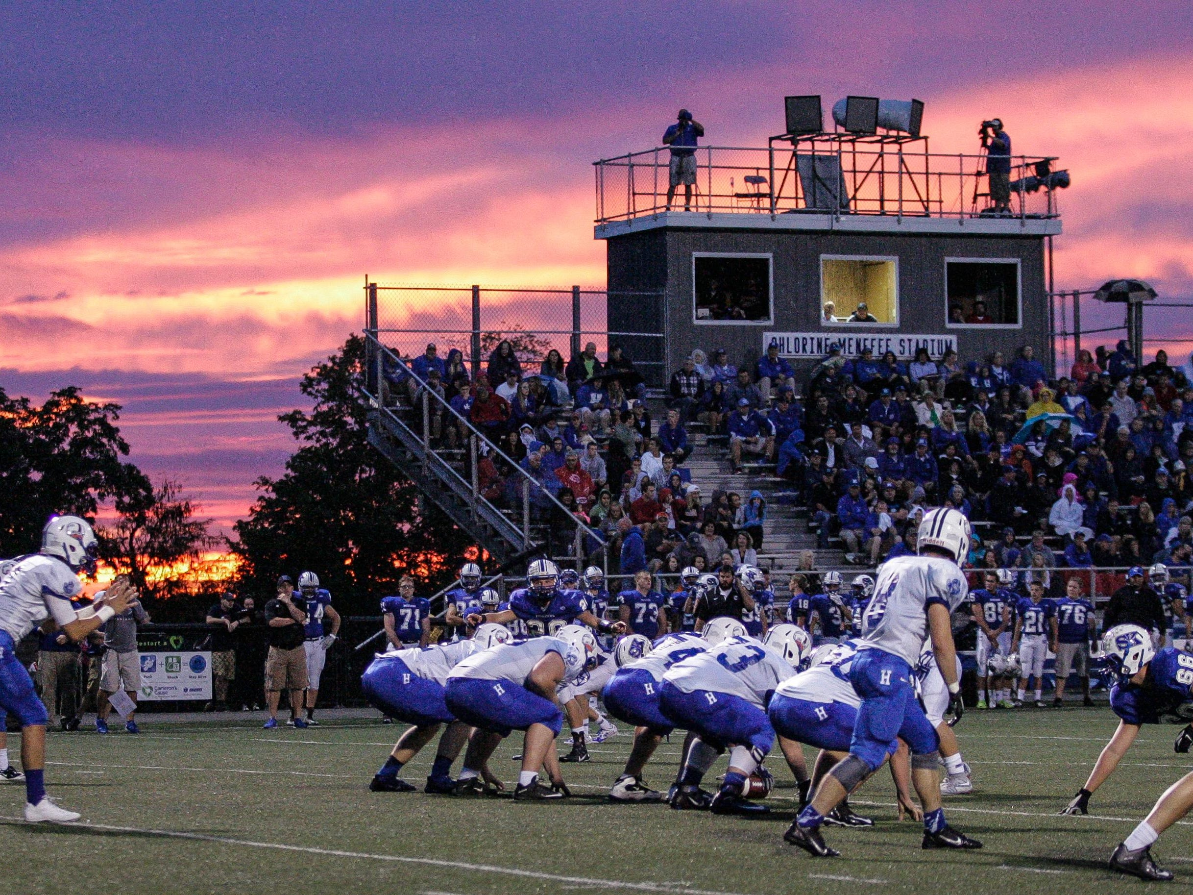Highlands quarterback Austin Hergott waits for a snap in front the sunset during the game at Simon Kenton Friday.