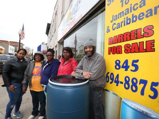 Caribreeze owner Dave King sells shipping barrels at