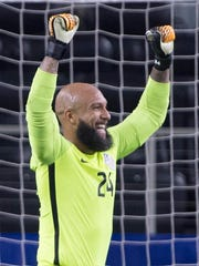 Tim Howard celebrates the USMNT's win over Costa Rica