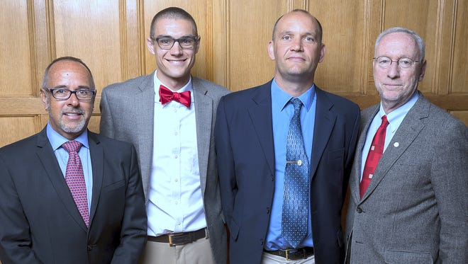 Painted Post native Samuel Chauvin was recently honored as one of Cornell University's top scholars. From left are Professor Jim Blankenship, Chauvin, high school history teacher Ray Lawson and Provost Michael Kotlikoff.