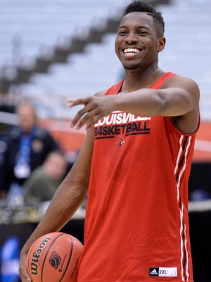 Mar 26, 2015; Syracuse, NY, USA; Louisville Cardinals forward/center Chinanu Onuaku (32) smiles during NCAA tournament practice at the Carrier Dome.