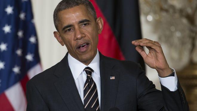 President Barack Obama  praises payday lender rules.