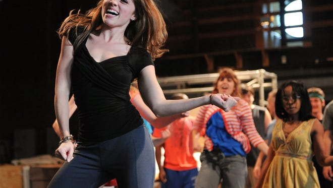 """In this 2011 photo, Jessica Murphy rehearses for a production of """"Camp Rock the Musical"""" at the Athenaeum."""