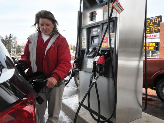 Jean Howland of Schofield refuels Friday at a Kwik Trip gas station on Schofield Avenue in Weston.