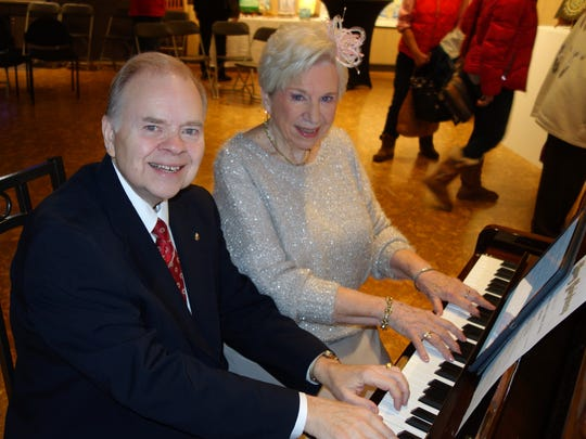 Holiday duet It was standing room only as Mark Hatfield and Eulalie Wilson shared their talent tinkling the ivories for a holiday concert. The one piano/four hands event was part of the Brown Bag series hosted by the Arts Council of Southwest Indiana.