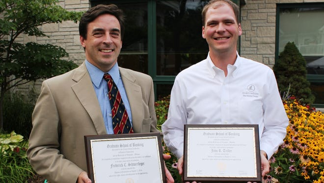 Horicon Bank's Ripon Vice President Fred C. Schwertfeger, left, and Branch Manager John Triller were recently awarded diplomas at commencement exercises during the prestigious Graduate School of Banking at the University of Wisconsin-Madison.
