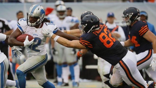 Andre Roberts, left, of the Detroit Lions shakes off a tackle attempt by Logan Paulsen of the Chicago Bears at Soldier Field on Oct. 2, 2016, in Chicago.