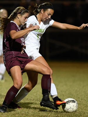 Henderson's Mary Kate Daniel (left) and Owensboro Catholic's Lilly Moore battle in the first period as the No. 11 Lady Colonels play No. 5 Owensboro Catholic in the semistate in Owensboro Monday, October 24, 2016.