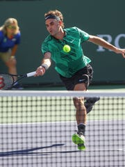Roger Federer hits a shot during his win over Stan Wawrinka during the men's finals at the BNP Paribas Open, March 18, 2017.