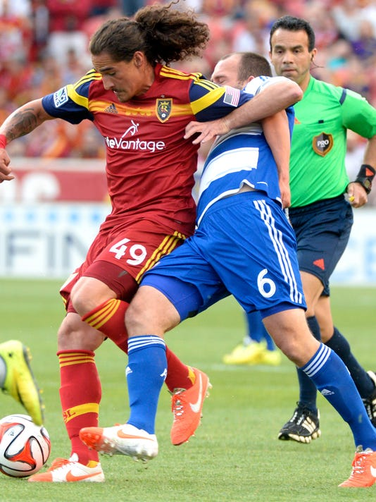 Real Salt Lake forward Devon Sandoval (49) gets tangled up with FC Dallas midfielder Adam Moffat (6) during an MLS soccer game on Saturday, May 24, 2014, in Sandy, Utah. (AP Photo/The Salt Lake Tribune, Rick Egan) LOCAL TV OUT; MAGAZINES OUT; DESERET NEWS OUT
