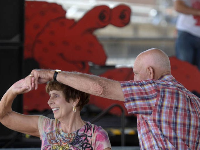 Jo Ann Crossno and Champ Crossno dance as La Recolte performs during the annual Mudbug Madness festival, Friday May 23, 2014, in Festival Plaza.