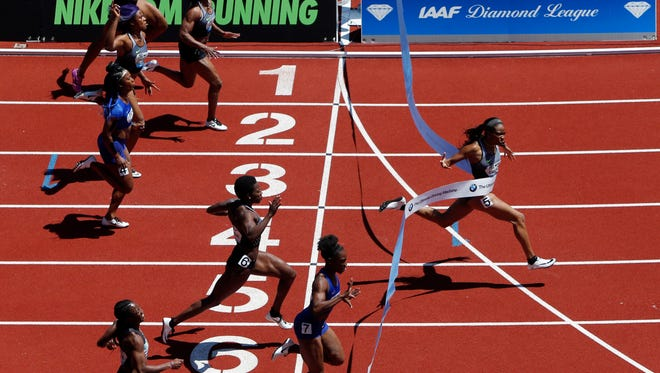 English Gardner crosses the finish line in 10.81 seconds, well ahead of the competition to win the women's 100 meters at the Prefontaine Classic athletics meet at Hayward Field in Eugene, Ore., on Saturday, May 28, 2016. (Andy Nelson/The Register-Guard via AP)