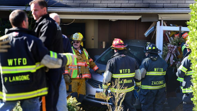 The car crashed through the front window area of the Washington Township home. The driver was not hurt, fire officials said; building department officials were to determine the house's structural stability.