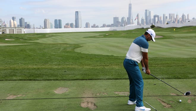 Jason Day is shown at the driving range at Liberty National Golf Club in Jersey City as he practices for the Presidents Cup. Wednesday, September 27, 2017