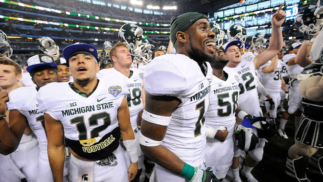 R.J. Shelton, left, and Tony Lippett, right, celebrate after MSU's come-from-behind 42-41 victory over Baylor in the Cotton Bowl Classic on Thursday at AT&T Stadium in Arlington, Texas.