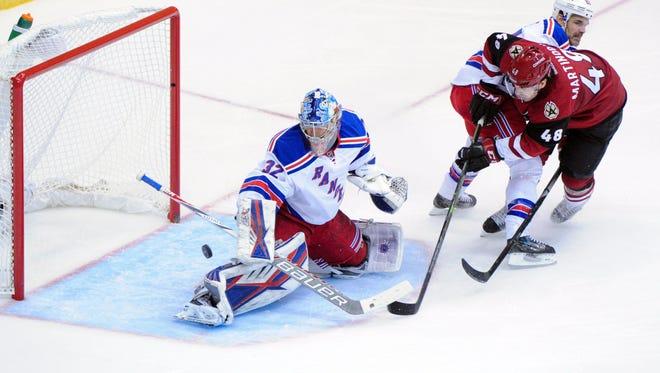 Coyotes left wing Jordan Martinook (48) shoots the puck on Rangers goalie Antti Raanta (32) in Glendale on Nov. 7, 2015.