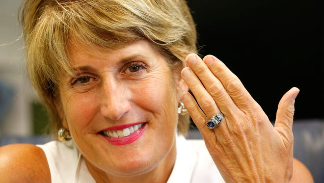 Principal Mary Beth Fitzgerald displays her swimming state championship ring Tuesday, June 21, 2016, at Wyandotte Elementary School in Lafayette. Fitzgerald and other members of Lafayette Jeff's 1975 state championship swimming team received the rings this week.