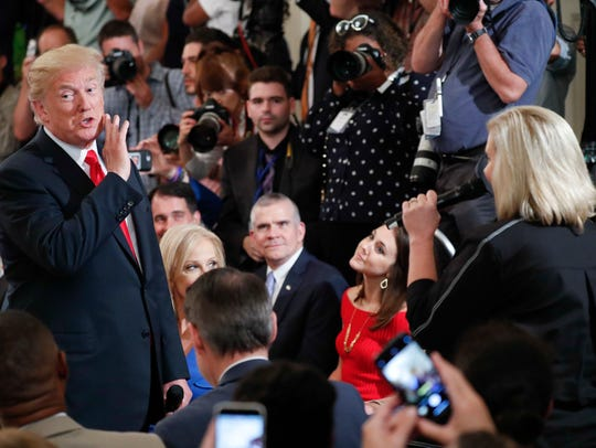 President Donald Trump gestures while speaking as he