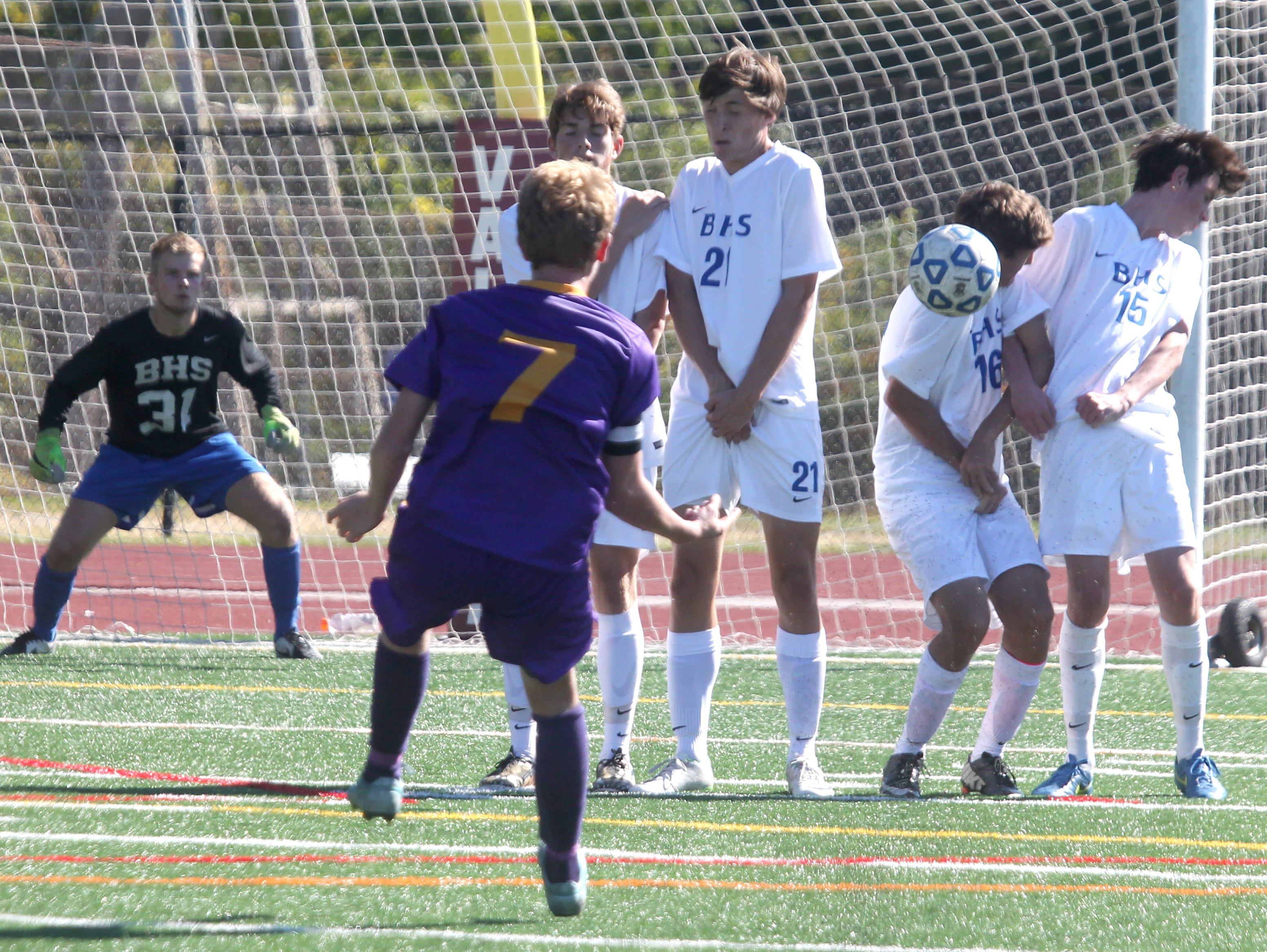 Bronxville's Dylan Weber (16) deflects a free kick by Rhinebeck's Ryan Euell during their Section 1 vs. Section 9 Challenge game at Valhalla Oct. 12, 2015. Bronxville won 4-0.