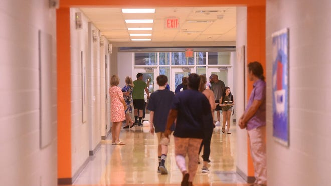 Students and parents make their way to class on the first day of school at College Park Elementary in 2019. Many elementary and middle school students will transition to a new location this school year due to redistricting.