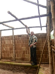 Site manager Carlos Paulino demonstrates how a rafter, cut from a tangantangan tree, is used in the building of a Chamorro hut at the Gef Pa'go Chamorro Cultural Village in Inarajan on Thursday, Jan. 7.