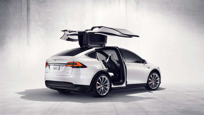 Tesla officially launched its Model X SUV during a flashy delivery event on Sept. 29, 2015.