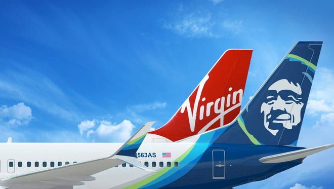 An image showing the tails of Alaska Airlines and Virgin America aircraft.